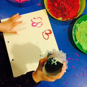 Autumn fruits motor-skills home made stencil painting activity in action