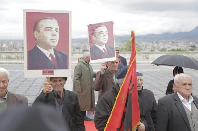 Albanian communists provoking while paying homage with the picture of former dictator Enver Hoxha