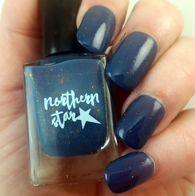 dark-blue-nail-polish-with orange-and-gold-flakes-and-pink-shimmer