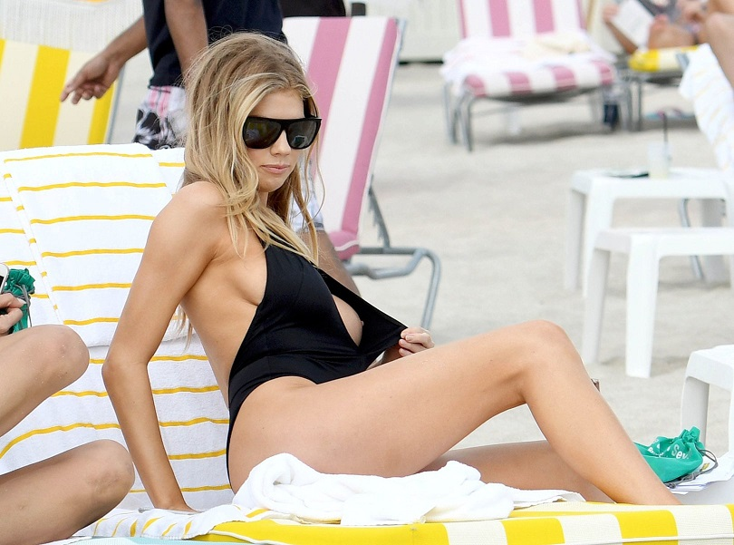 Baywatch's Charlotte McKinney suffers epic nip slip in skimpy swimwear