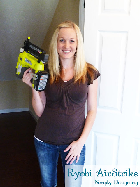 Ashley Phipps from Simply Designing Holding a Ryobi AirStrike nail Gun