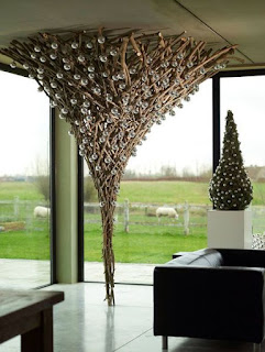 A tree design made from bare branches and glass balls
