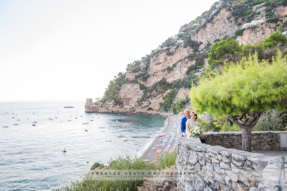 Bride and groom overlooking Fornillo beach