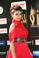 Apoorva in a Stunning Tight Leg Split Sleeveless Red Gown at IIFA Utsavam Awards 23.JPG