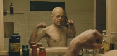 benjamin button mirror medicines brad pitt muscles flex glasses glass bottles bathroom old young