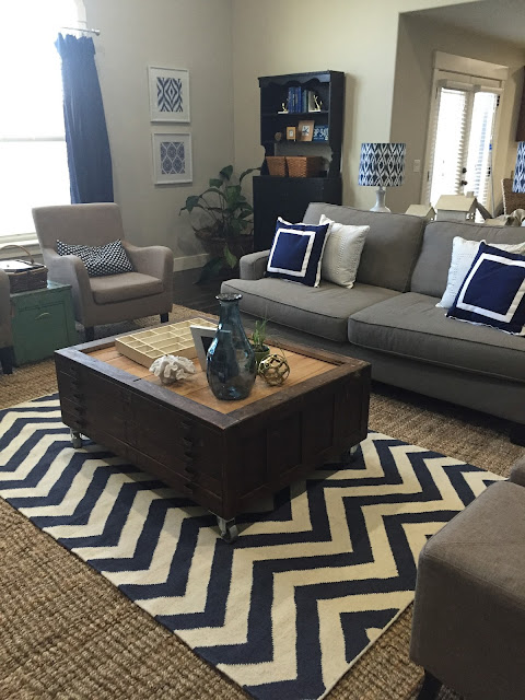 Grey couch, sisal rug Great Room Reno at www.jengallacher.com