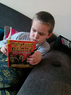 Top Ender reading the Terry Deary Shakespeare Tales Macbeth after School