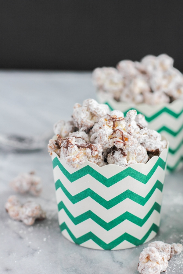 This decadent sweet and salty treat is made by coating popcorn in melted peanut butter and dark chocolate, then tossing it lightly in powdered sugar. Puppy Chow Popcorn is a family favorite snack that's perfect for movie night or watching the big game!