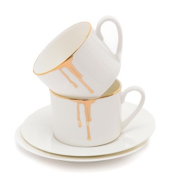 Drip gold and white coffee mugs