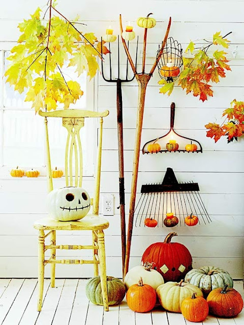 These hanging rakes and vintage pumpkins are perfect fall decor.