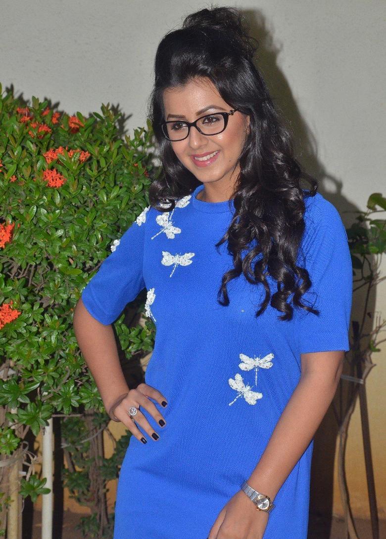 Actress Nikki Galrani Stills In Mini Blue Dress With Glass
