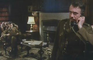 Screenshot from Spy! Episodee 2 - Camp 020 - BBC - 1980 The Major receives a call from the Commandant in the Officer's Mess.
