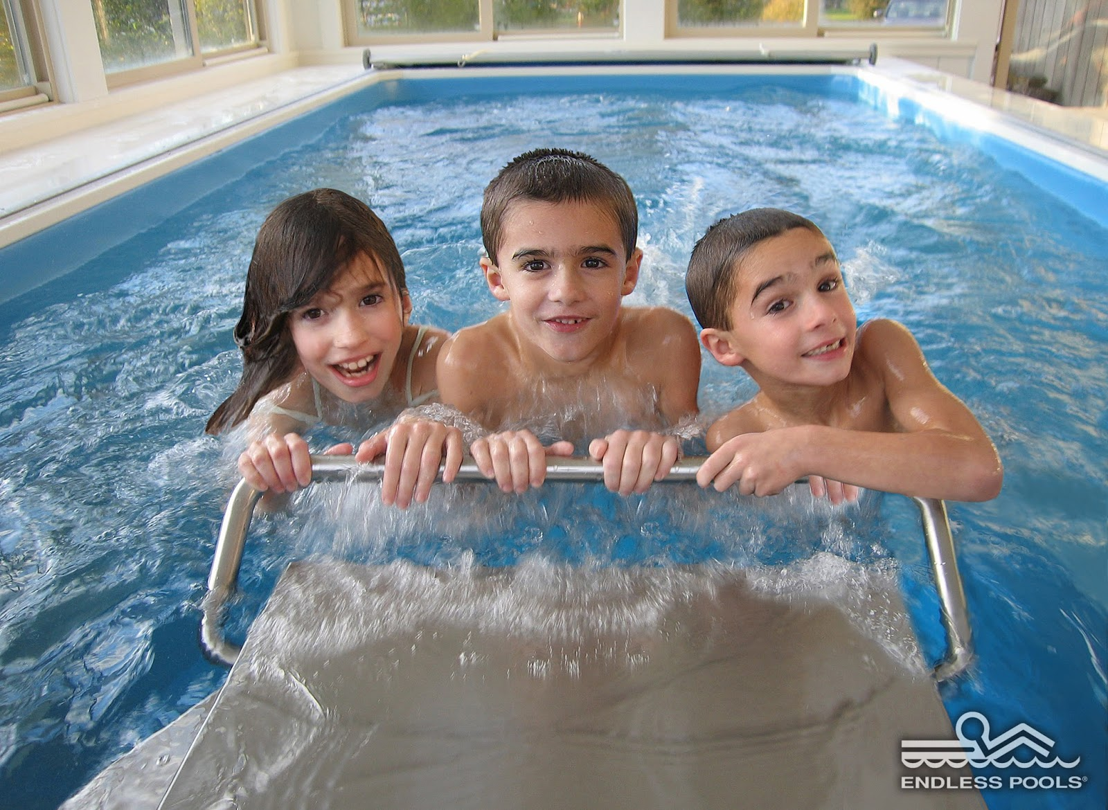 Pool with current to swim against - Three Children Enjoy Their Family S Home Endless Pools Swimming Machine