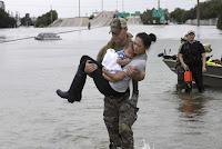 Hurricane Harvey (Photo Credit: David J. Phillip) Click to Enlarge.