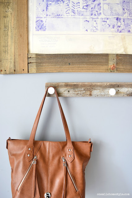 Update your entryway with a DIY reclaimed wood organizer, and large statement art to add a personal touch to the space.