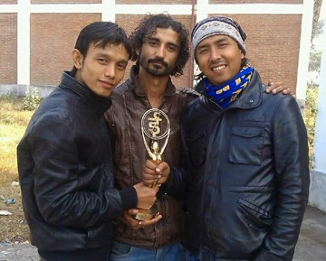 Vaani band members with their coveted trophy.