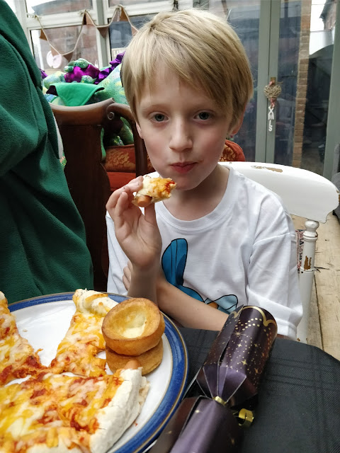 Boy with autism enjoying Iceland pizza on Christmas Day