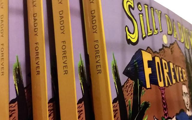 Silly Daddy Comics on book shelf by Joe Chiappetta