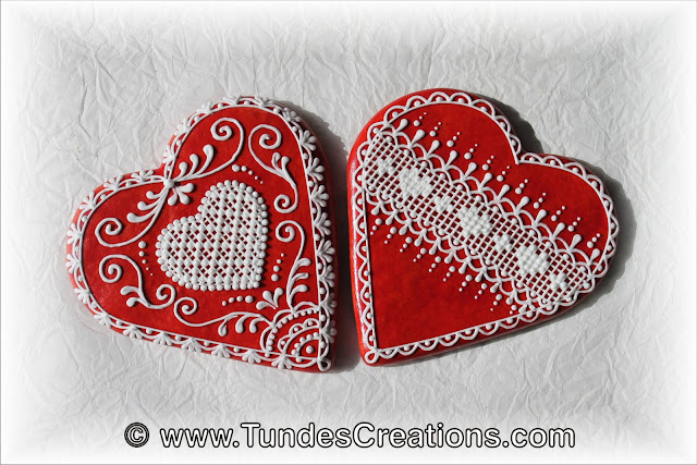 Big red gingerbread hearts with lace by Tunde Dugantsi