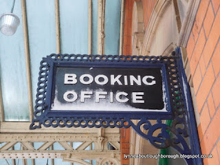 A snowy booking office sign at the GCR Loughborough
