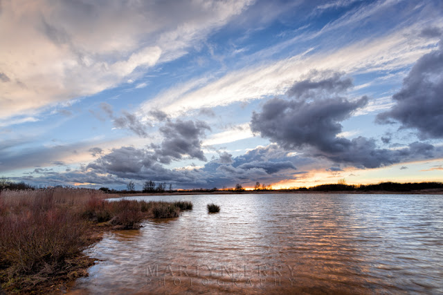 Big clouds in the sky at Ouse Fen Nature Reserve in the Cambridgeshire Fens