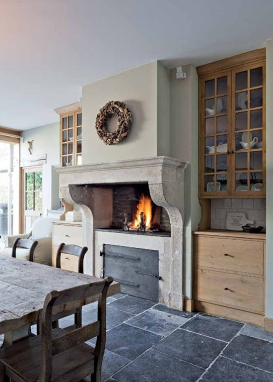 A large fireplace in the kitchen. Image via 'Building and Renovating with Reclaimed Materials' found via Belgian Pearls.
