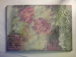 A4 canvas board with grunge paste in squares and curls coloured in greens, pinks and purples