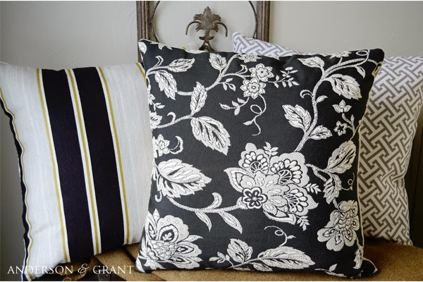 Three decorative throw pillows
