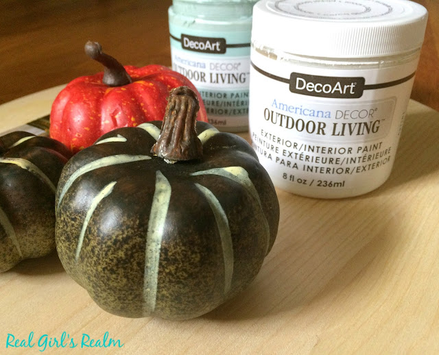 Paint your pumpkins with chalk paint for a neutral look