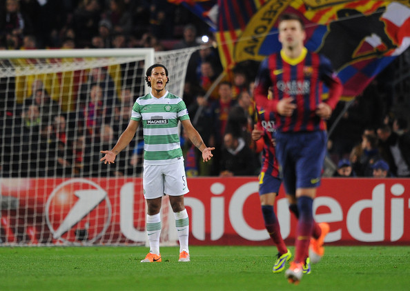 Virgil van Dijk of Celtic FC reacts after FC Barcelona scored their opening goal during the UEFA Champions League, Group H match between FC Barcelona and Celtic FC at the Camp Nou Stadium on December 11, 2013 in Barcelona, Spain
