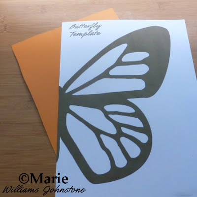 Paper with wing printed on to it and orange card