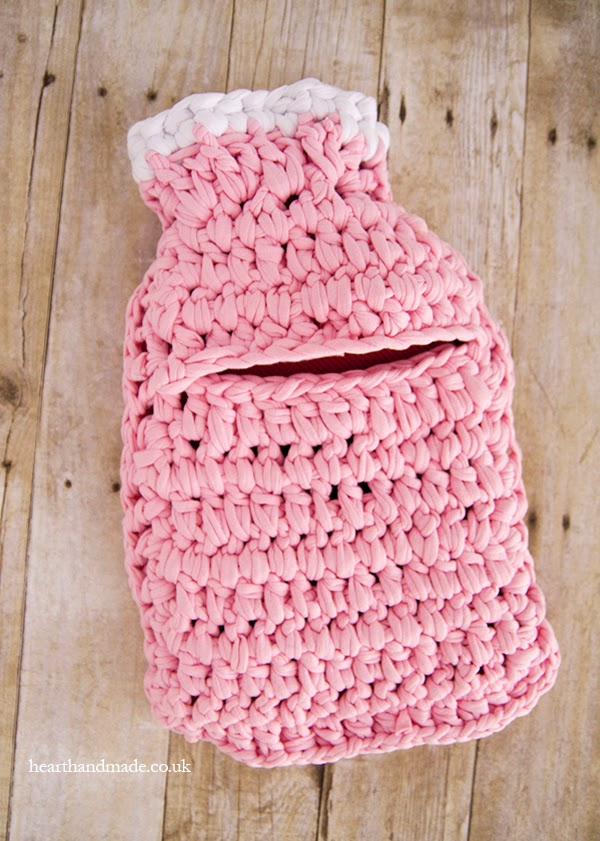 the finished zpagetti yarn crochet hot water bottle cover