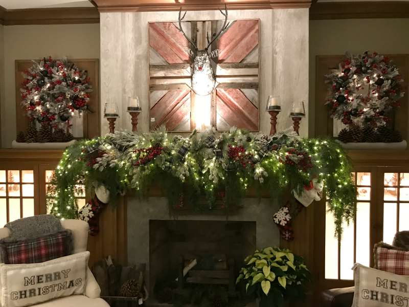 a fire place decorated with plaid Christmas decorations