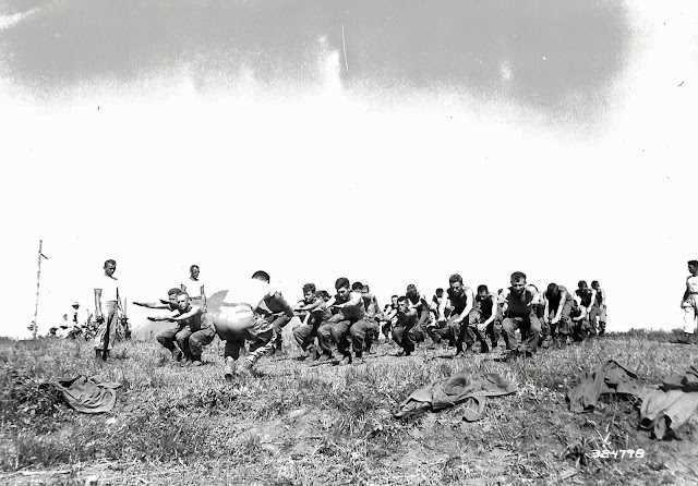 US Army soldiers exercising while at Lipa Airfield.  Image source:  United States National Archives.