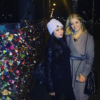 Janel Parrish and Sasha Pieterse on Lovers Bridge in Germany for PLL Convention