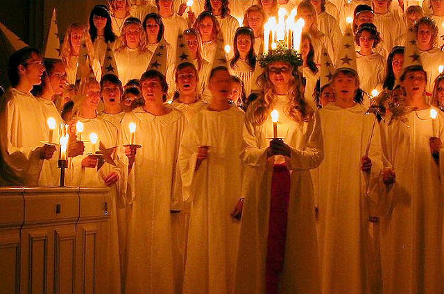 Santa Lucia procession is led by one girl crowned with a wreath of candles or lights. Photo: WikiMedia.org.