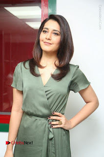 Actress Raashi Khanna Stills in Green Short Dress at Mirchi 95 Suno Aur Mercedes Jeeto Contest  0099.JPG