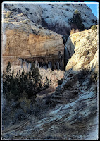 First View of Upper Calf Creek Falls in the distance you can see the canyon it is falling into and the White boulder Mountains surrounding the  are in Escalante Nataional Park in Utah by Boulder