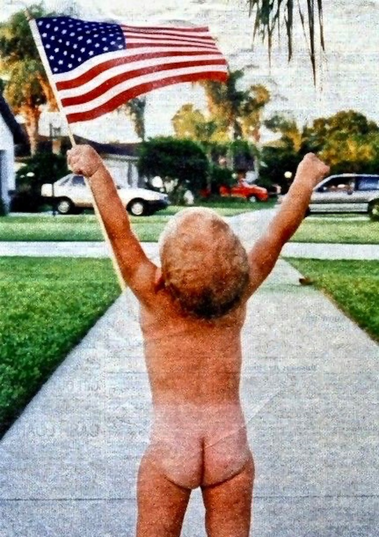 Photo of a cute toddler holding up an American Flag. Snark on the 4th and other stories about Merica. marchmatron.com