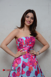 Actress Tamanna Latest Images in Floral Short Dress at Okkadochadu Movie Promotions  0103.JPG
