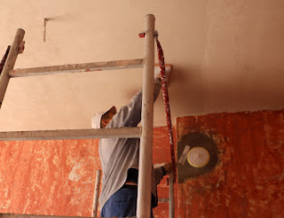 Yulhan polishing the ceiling plaster