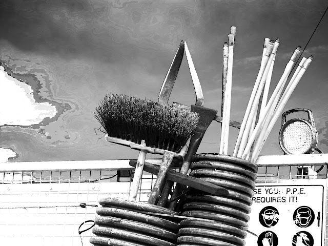 Broom and other workers' implements on back of lorry - black and white - greater contrast