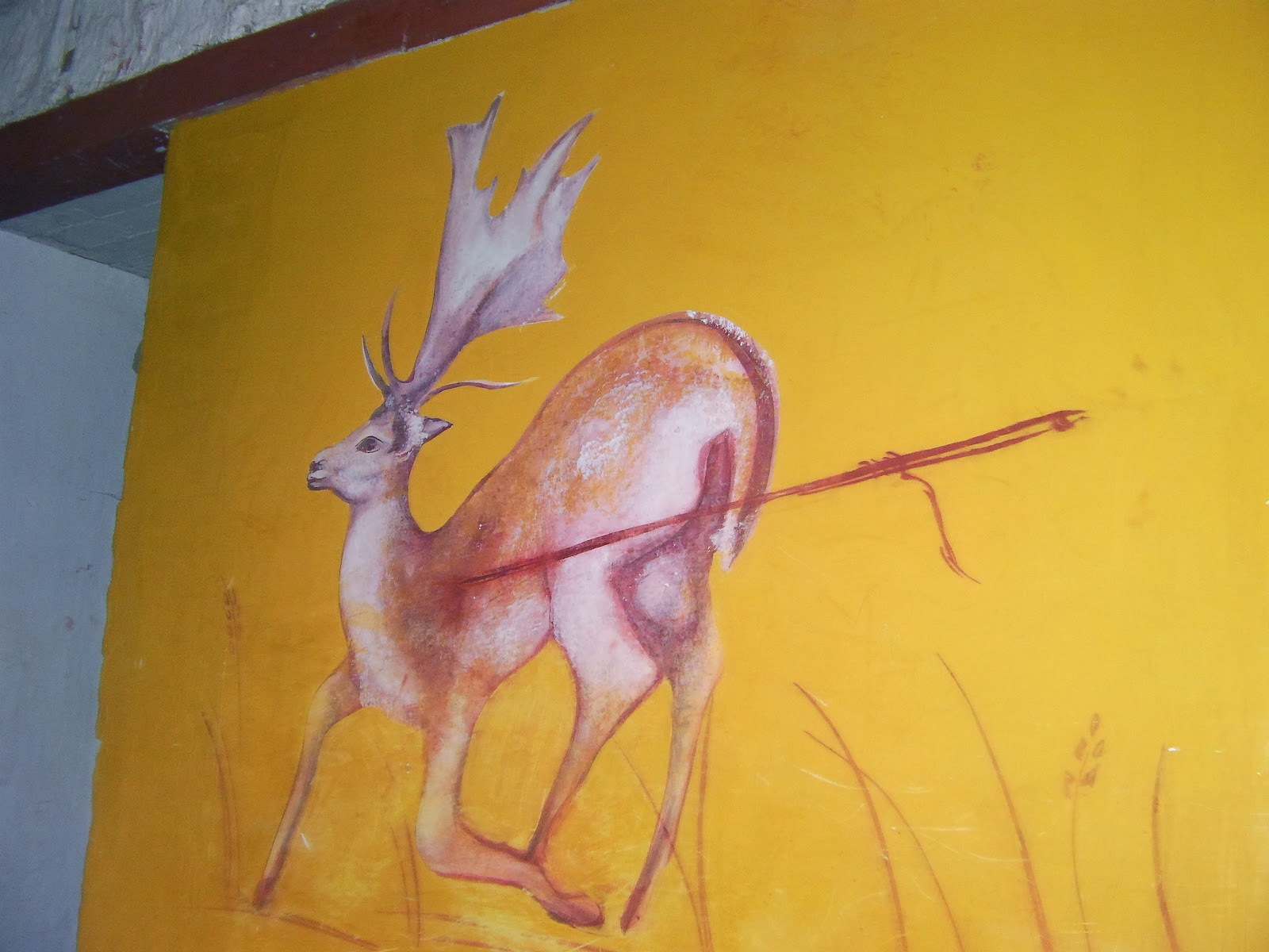 deer stuck with spear cave painting