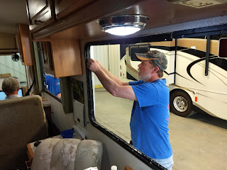 man working on motorhome window
