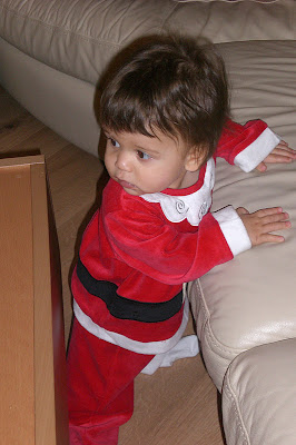 Small child in a Santa outfit