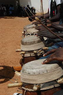 Drummers hammer out traditional Senegalese music as audience members take turns dancing.
