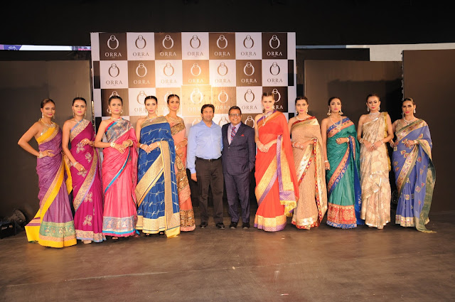 Mr. Mehta, Chairman ORRA and Mr. Vijay Jain, CEO - ORRA with  Models showcasing exquisite jewellery at the launch of Orra Jewellery's flagship store in Bengaluru
