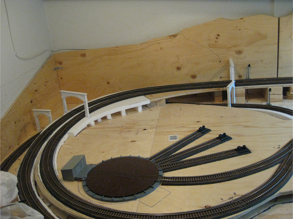 Two single and two double styrene tunnel portals placed on model railroad track to test fit