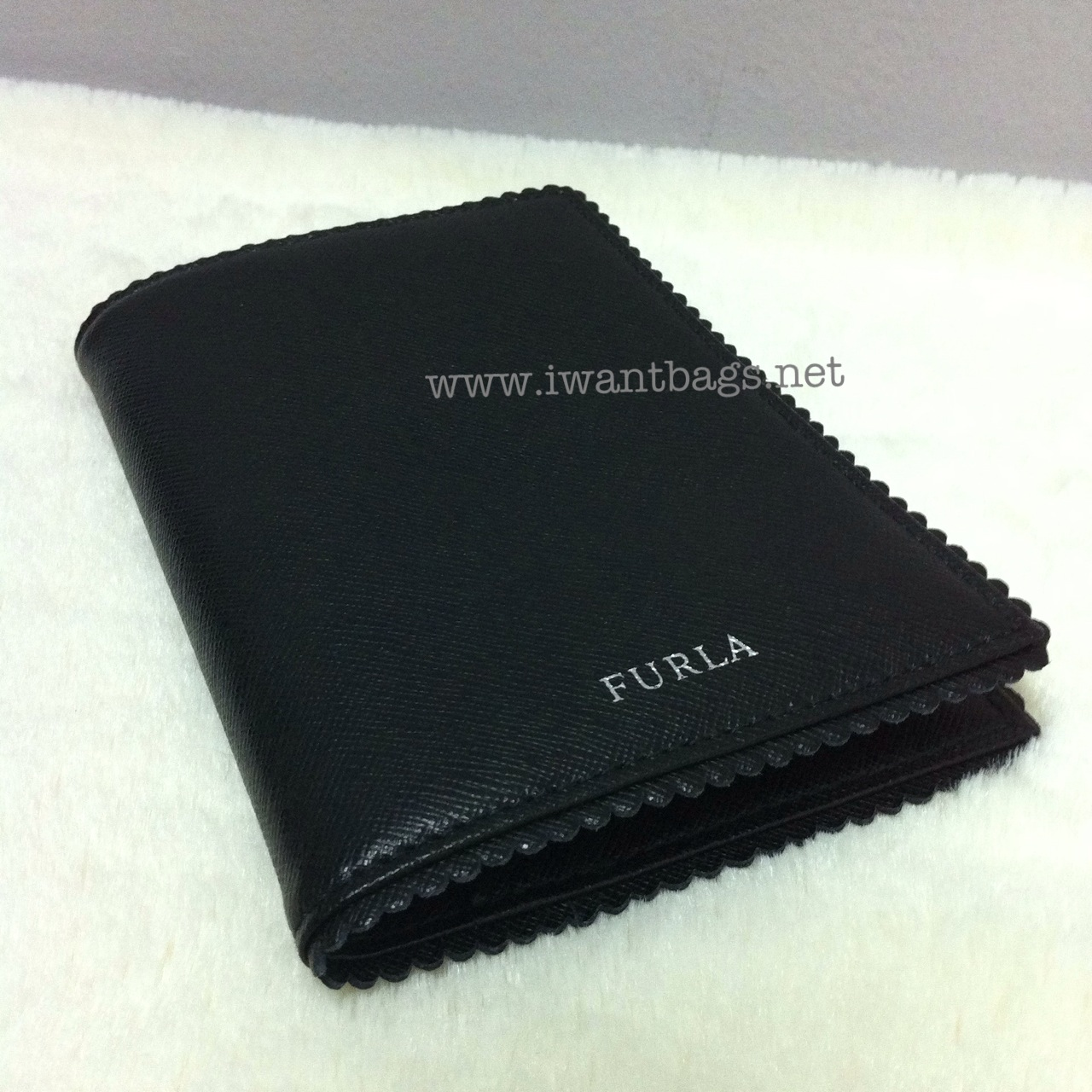 69a988885589 I Want Bags backup: Furla Leather Passport Holder