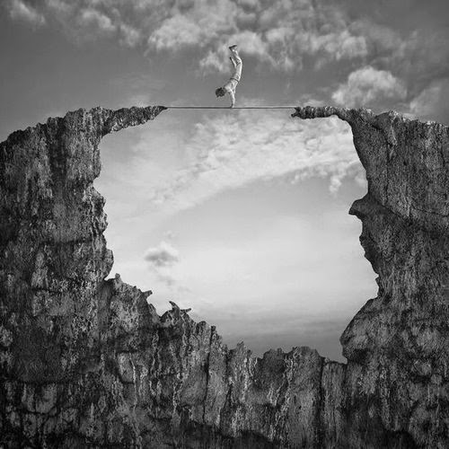 13-Acrobat-Dariusz-Klimczak-Black-and-White-Surreal-Altered-Reality-www-designstack-co